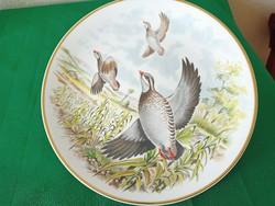 Flying birds in English porcelain bowl