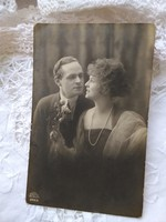 Antique romantic postcard / photo card with couple in love, string of pearls, roses 1924