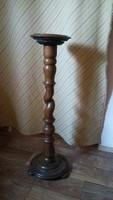 Old tall wooden pedestal with flowerpot